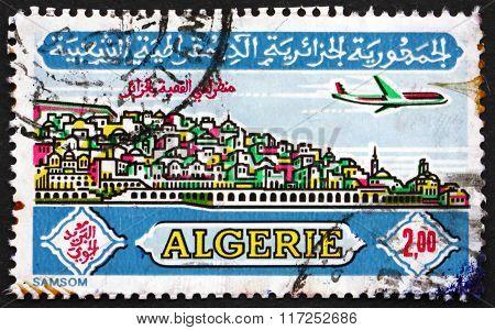 ALGERIA - CIRCA 1971: a stamp printed in Algeria shows Plane over Casbah Algiers circa 1971