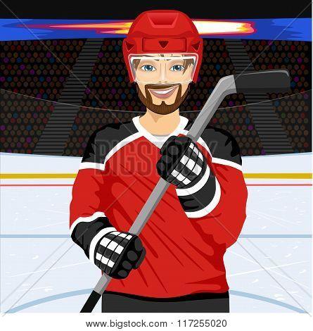male ice hockey player with an ice hockey stick