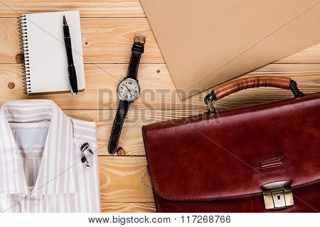 overhead view of business accessories and Businessman outfit on wooden background poster