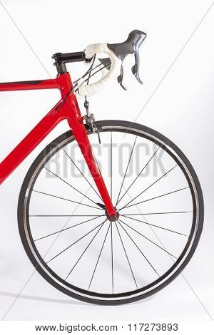 Bicycle Concept. Partial View Of Front Part Of Professional Road Bike. Against White.