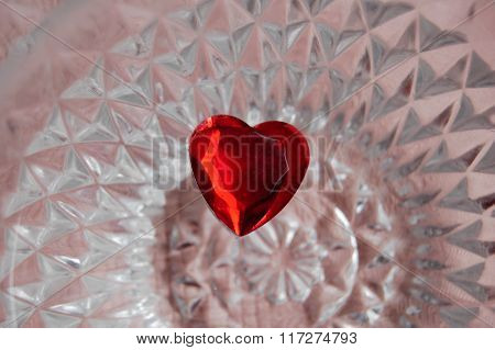 Red heart on a pink crystal background