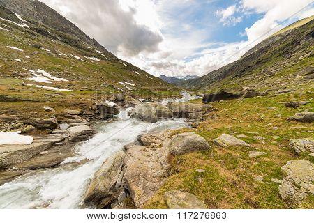 High Altitude Alpine Stream With Dramatic Sky