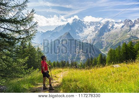 Hiker Resting In Front Of Majestic Monte Bianco (mont Blanc)
