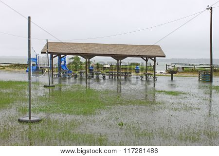 A flooded beach front picnic and play area