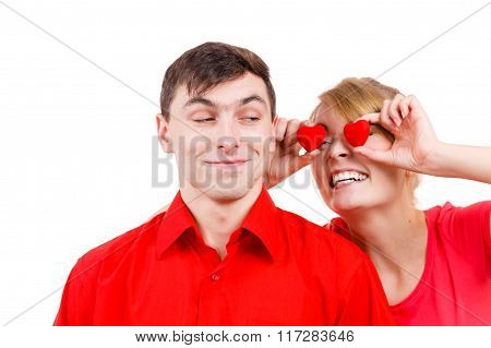 Man And Crazy Woman Holds Red Hearts Over Eyes