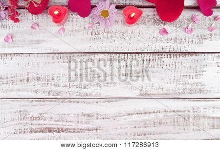 Composition With Candles, Flowers And Hearts On White Rustic Wooden Background With Copy Space For T