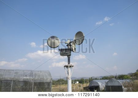 Anemometer In A Farm With Blue Sky