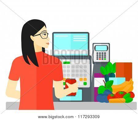 Cashier at supermarket checkout.