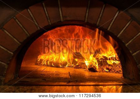 Fire wood burning in the oven