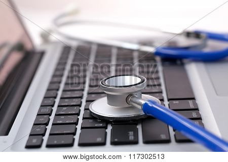 poster of Stethoscope on laptop - Computer repair and maintenance concept