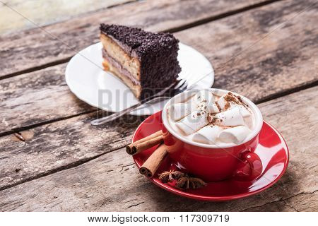 Hot Cocoa With Marshmallows And Slice Of Cake