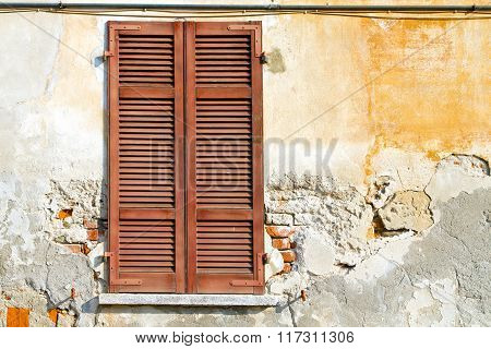 red window varano borghi palaces italy abstract sunny day wood venetian blind in the concrete brick poster