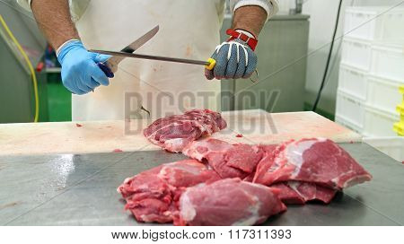 Butcher Sharpening Knife On Sharpening Steel