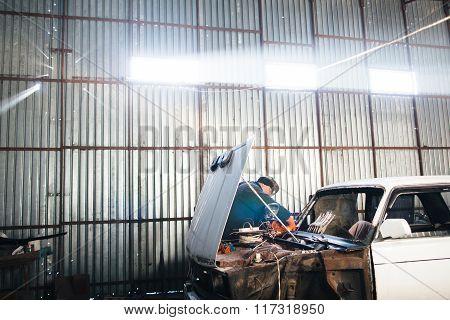 Mechanic repair and service car in garage