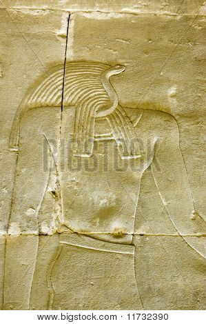 Ancient Egyptian stone carving of the snake headed god Apophis (Aapep) associated with the underworld and chaos.  Interior chapel wall of the Temple of Horus, Edfu, Egypt poster