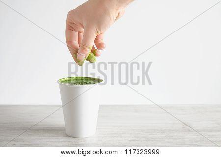 Woman Pours Green Powder In Matcha Latte
