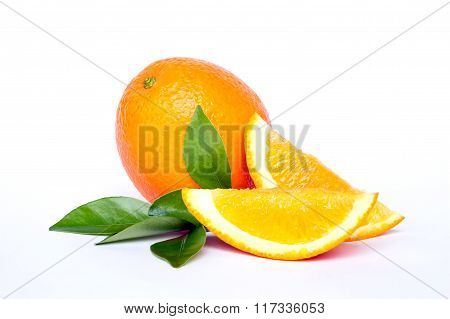 Navel seedless orange and slices of orange with leaves