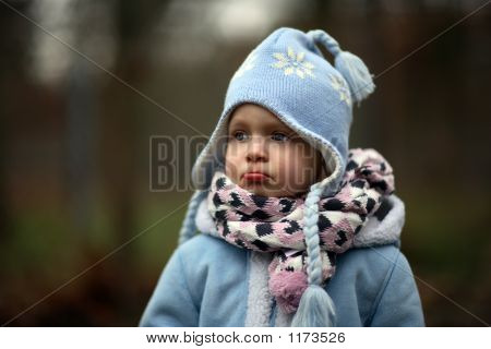 a little girl in the cold winter poster