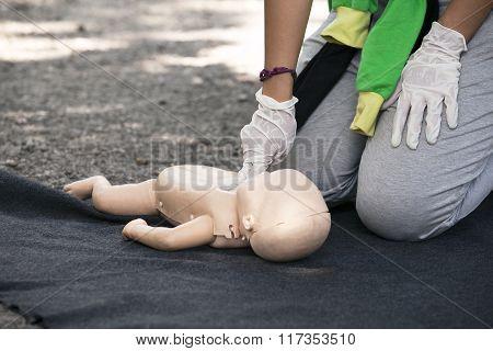Infant dummy first aid training