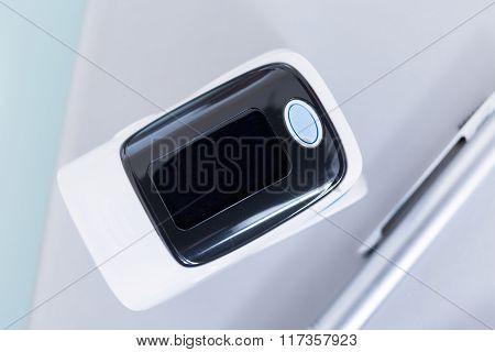 Close-up Of Finger Pulse Oximeter