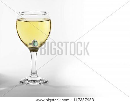 Glass with engagement ring
