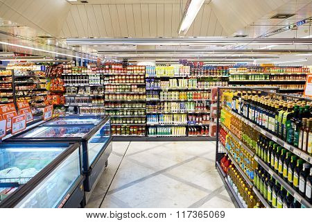 GENEVA, SWITZERLAND - SEPTEMBER 19, 2015: interior of Migros supermarket. Migros is Switzerland's largest retail company, its largest supermarket chain and largest employer