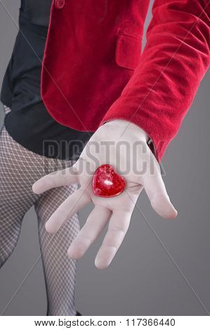 Hand holding a red heart