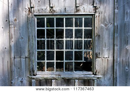 Old rustic shed with thirty pane window