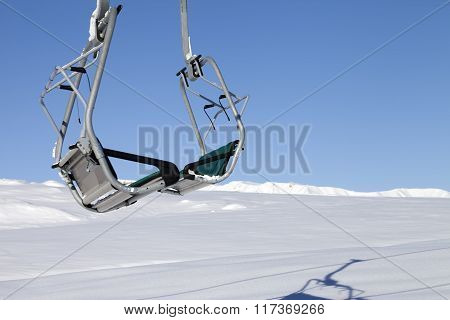 Chair-lift In Ski Resort At Sun Day After Snowfall