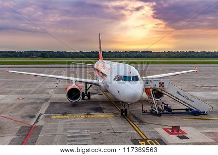 MALPENSA, ITALY - SEPTEMBER 22, 2015: Easyjet airplane on parking in Milan Malpensa airport - largest airport for Milan metropolitan area, serves 15 million inhabitants, has 2 terminals and 2 runways.