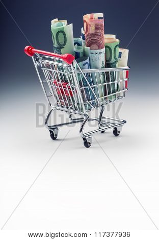 Shopping trolley. Shopping cart. Shopping trolley full of euro money - banknotes - currency.
