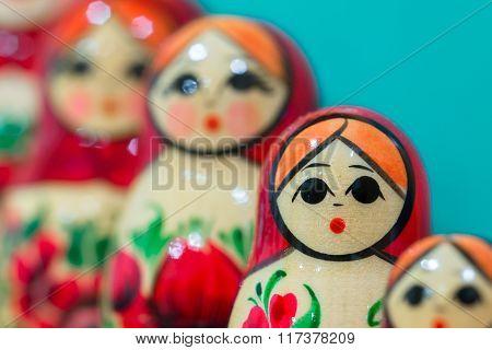 Red Matryoshka dolls on blue background