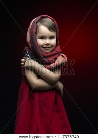 Cute Child Shivering In The Cold Isolated On Black