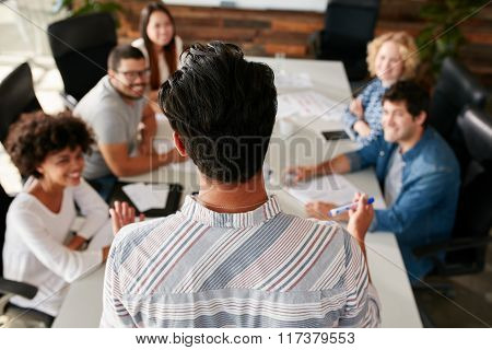 Man Explaining Business Ideas To Colleagues