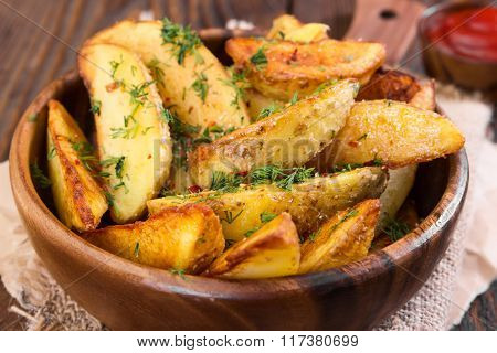 Potato Wedges With Dill On Wooden Background
