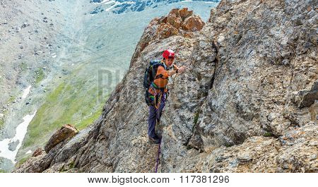 Person climbs mountain