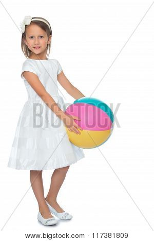 child plays with a ball