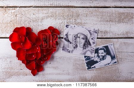 Photos of a couple in love. Red rose petal heart.