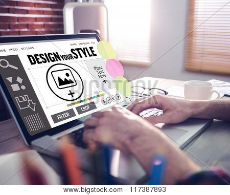 Designer interface against cropped image of graphic designer working on laptop