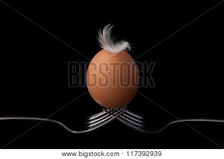 Chicken Eggs On Fork Still Life On Black Background