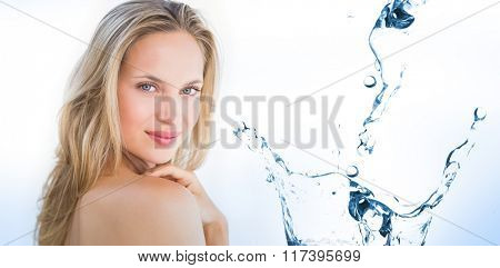 Water bubbling on white surface against pretty blonde sitting on massage table