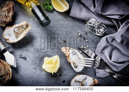 Fresh Oysters With White Wine And Lemon On Stone Background