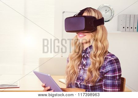 Pretty casual worker using oculus rift against a empty office with a laptop