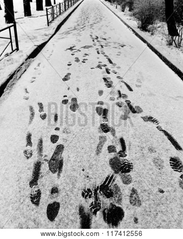 Many Traces Of Soles In The Snow In The Alley
