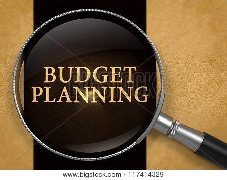 Budget Planning Concept through Magnifier.