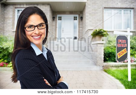 Real Estate agent woman near new house. poster