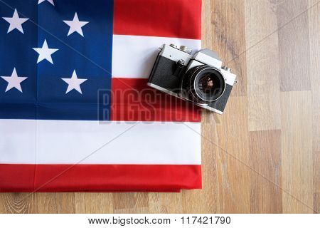 top view American flag and retro photo camera background
