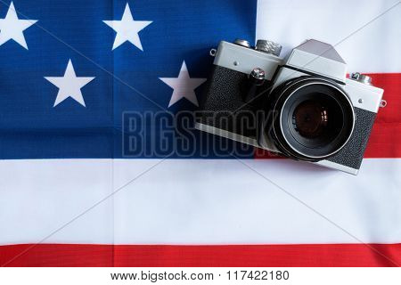 American flag and retro photo camera background