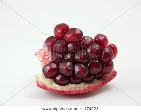 Pomegranate Seeds In Macro On White