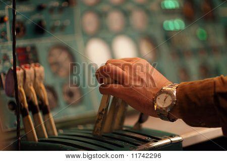 Flight Engineer Holds Handle Of Throttle